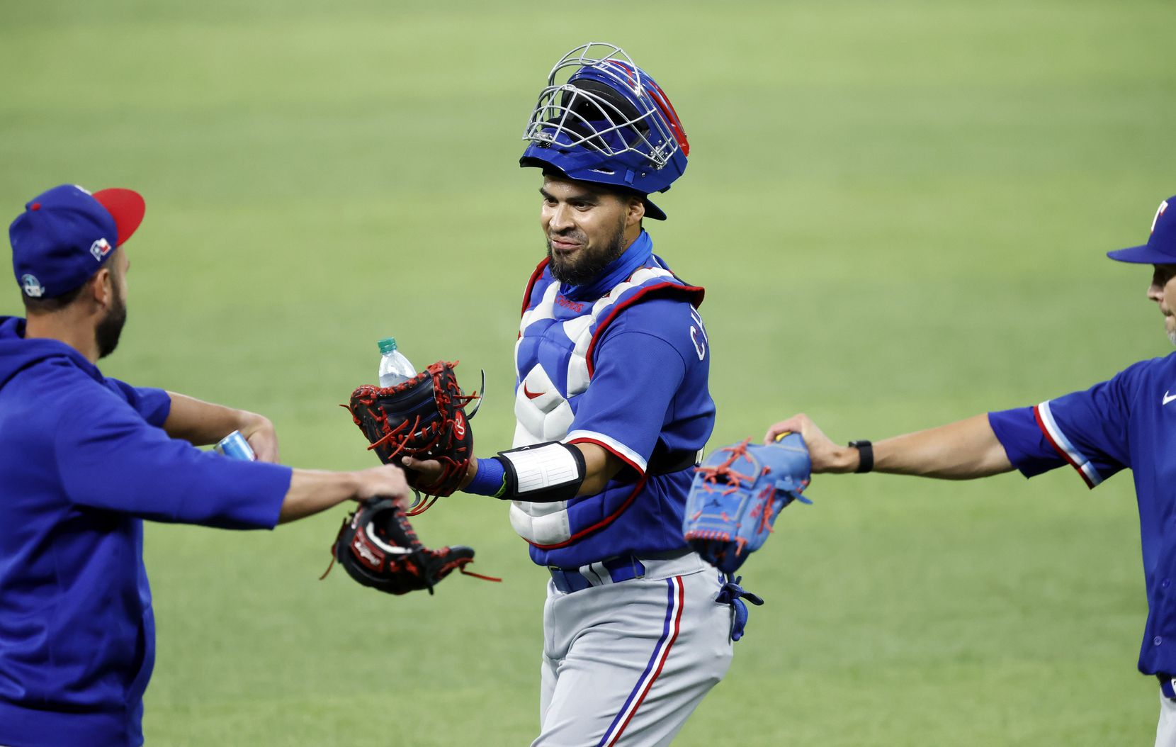 Texas Rangers catcher Robinson Chirinos (center) receives a fist bump from a teammate before a simulated Summer Camp game inside Globe Life Field in Arlington, Texas, Thursday, July 9, 2020. (Tom Fox/The Dallas Morning News)