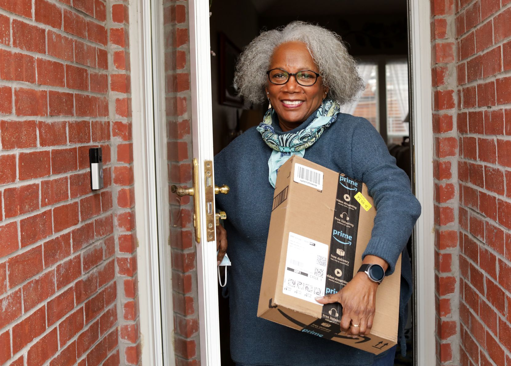 """Carolyn Bryels, 73, lives by herself in Carrollton. One """"unfortunate"""" habit she's picked up during the pandemic is shopping online. """"The Amazon guys love me,"""" she says."""