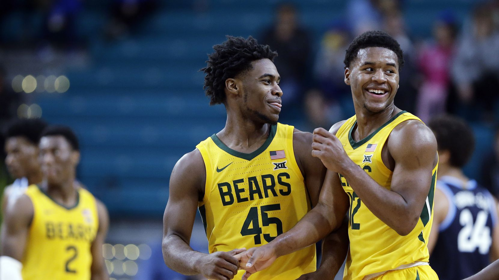 FILE - In this Sunday, Nov. 24, 2019 file photo, Baylor guard Davion Mitchell (45) and guard Jared Butler (12) react late in the second half of an NCAA college basketball championship game against Villanova at the Myrtle Beach Invitational in Conway, S.C. There really are no tougher matchups for Baylor guards Jared Butler, Davion Mitchell and MaCio Teague than in those countless hours they spend in the gym going 1-on-1 against each other. Or for opposing teams when that trio of guards is on the court together for the Bears, the Big 12 champions and a No. 1 seed in the NCAA Tournament for the first time.  (AP Photo/Gerry Broome, File)