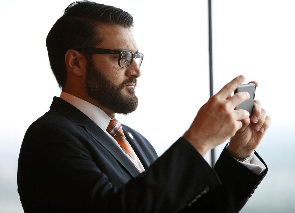 Hamdullah Mohib, Afghanistan's ambassador to the U.S., takes a shot of Las Colinas  from the La Cima Club as guests and honorees gather to honor women from Afghanistan and Rwanda who have completed studies in entrepreneurial skills.