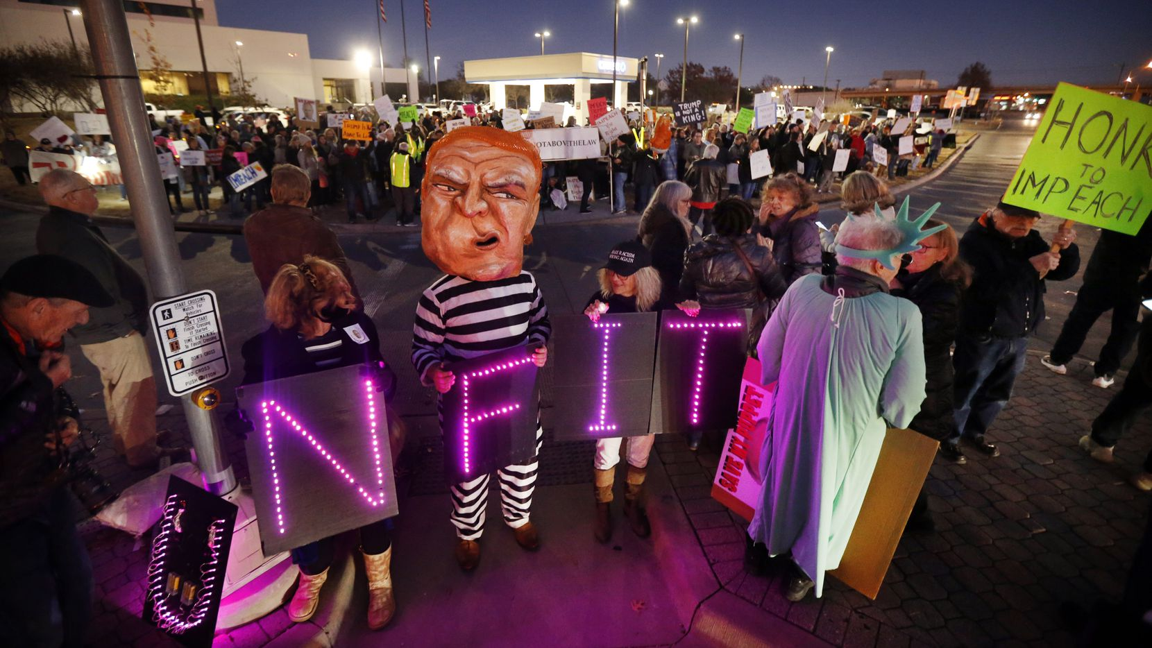 Supporters of U.S. Representative Colin Allred gathered outside his Richardson, Texas office at the intersection of Belt Line Rd and Central Expressway to show their support of President Donald Trump's impeachment, Tuesday evening, December 17, 2019.