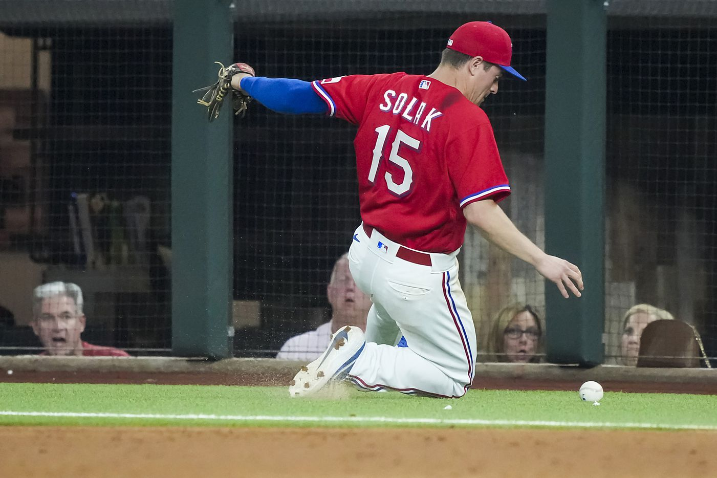 Texas Rangers second baseman Nick Solak chases an overthrown ball in foul territory during the ninth inning against the Minnesota Twins at Globe Life Field on Friday, June 18, 2021.