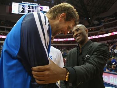 Dirk Nowitzki #41 of the Dallas Mavericks greets Kobe Bryant #24 of the Los Angeles Lakers after a game at American Airlines Center on November 5, 2013 in Dallas, Texas.