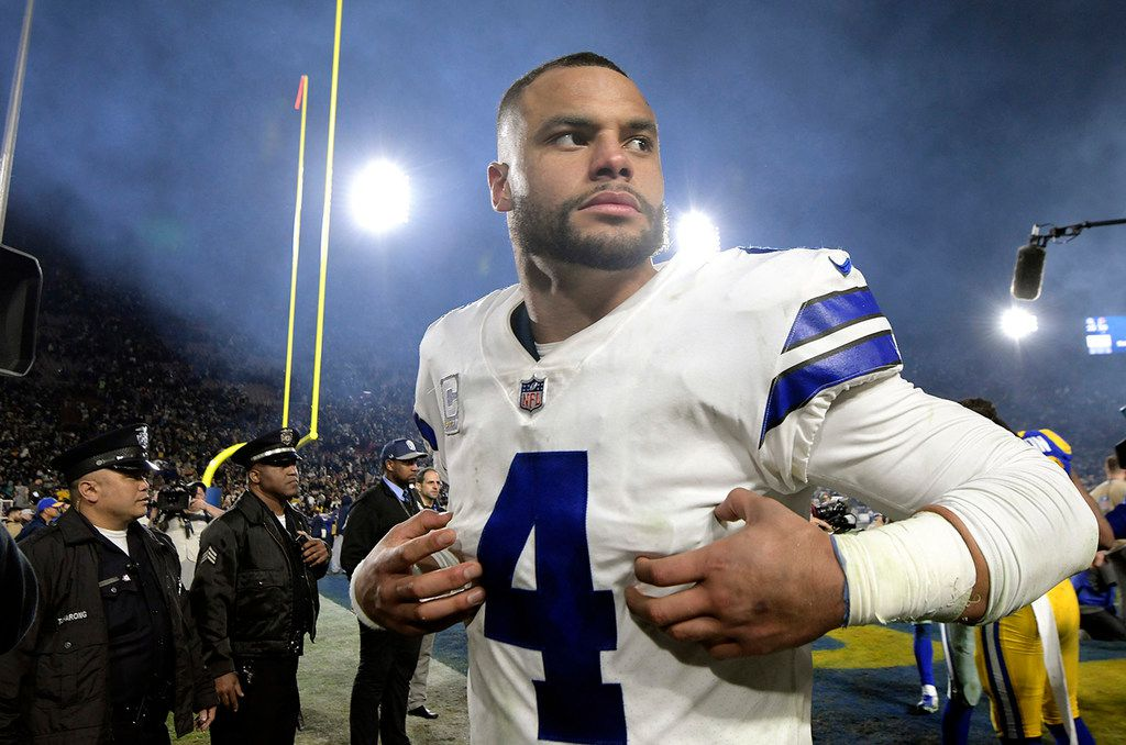 Dallas Cowboys quarterback Dak Prescott (4) walks off the field after a 30-22 loss against the Los Angeles Rams in the NFL Divisional Round at the Los Angeles Memorial Coliseum on Jan. 12, 2019. (Max Faulkner/Fort Worth Star-Telegram/TNS)
