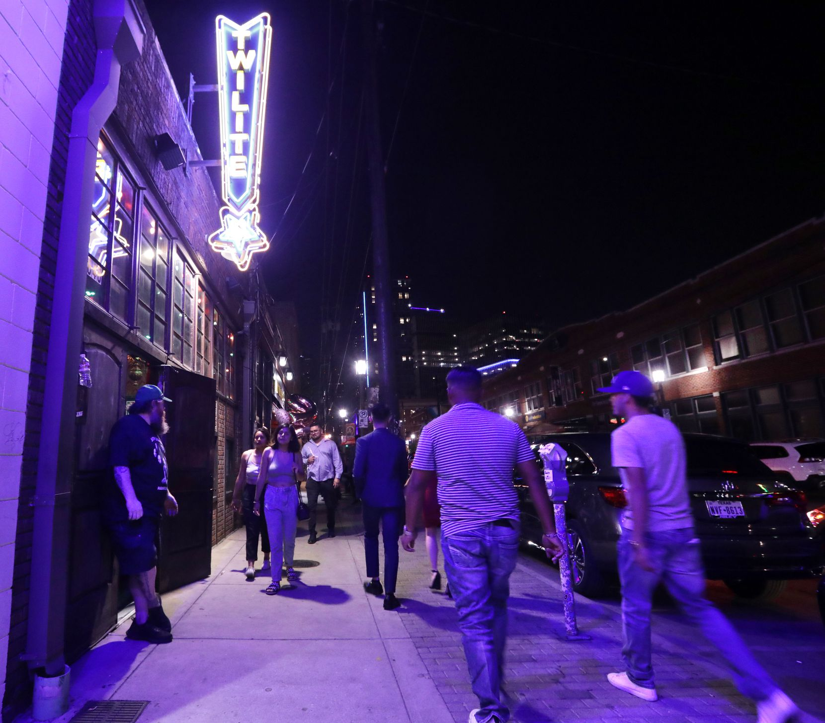 People look for food, drinks, music, and fun as they walk the streets of Deep Ellum in Dallas, TX, on Aug. 27, 2021.  (Jason Janik/Special Contributor)