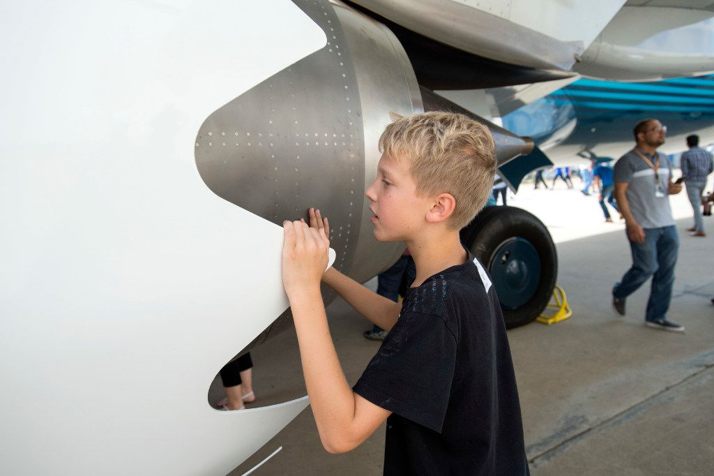 Jeremy Hunt, 10, takes a peek inside a jet engine on one of Southwest Airlines' new Boeing 737 MAX jetliners at Love Field in Dallas on Friday, September 23, 2016.  The engines were designed to be quieter and more fuel efficient. (Jeffrey McWhorter/Special Contributor)