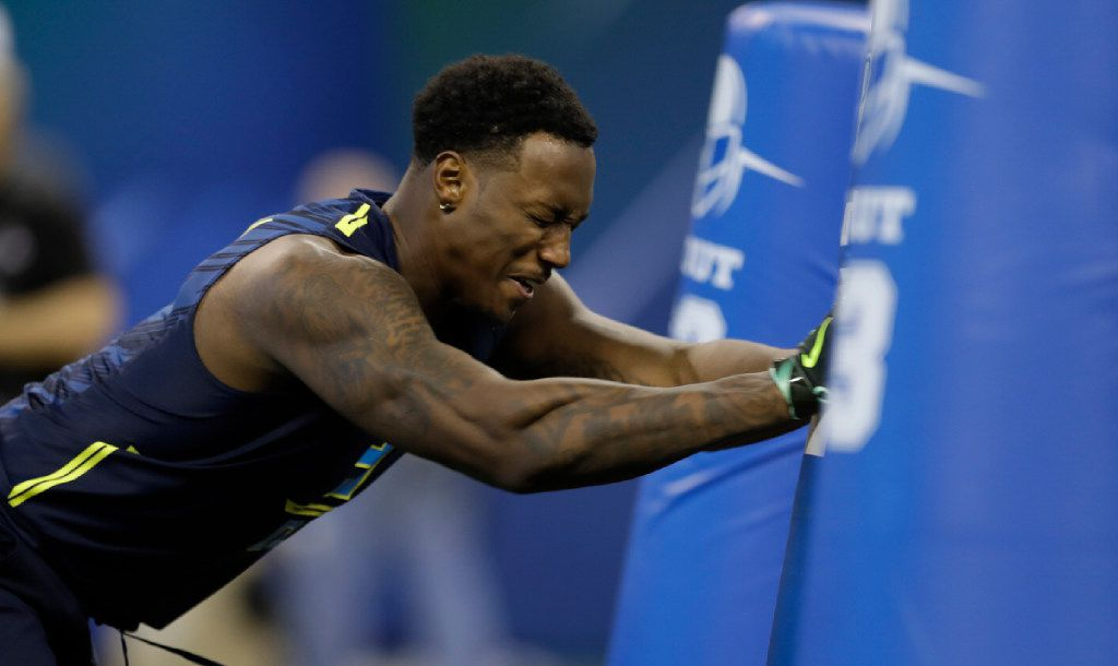 Michigan defensive end Taco Charlton runs a drill at the NFL football scouting combine Sunday, March 5, 2017, in Indianapolis. (AP Photo/David J. Phillip) ORG XMIT: INDP