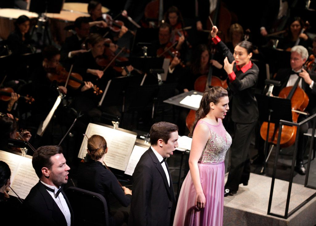 Tianyi Lu conducts during the Institute For Women Conductors event at the Winspear Opera House in Dallas on Dec. 10, 2016.