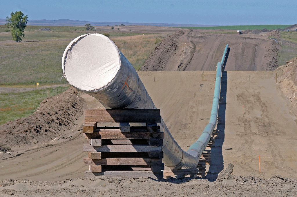 FILE - This Sept. 29, 2016, file photo, shows a section of the Dakota Access Pipeline under construction near the town of St. Anthony in Morton County, N.D. The Army has notified Congress Tuesday, Feb. 7, 2017, that it will allow the $3.8 billion Dakota Access pipeline to cross under a Missouri River reservoir in North Dakota, completing the four-state project to move North Dakota oil to Illinois. The Army intends to allow the crossing under Lake Oahe as early as Wednesday, Feb. 8. The crossing is the final big chunk of work on the pipeline.  (Tom Stromme/The Bismarck Tribune via AP, File)