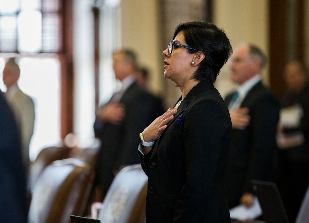 State Sen. Jessica Gonzalez recites the Pledge of Allegiance  on the third day of the 86th Texas Legislature in Austin.