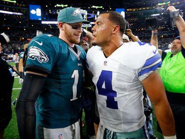 Philadelphia Eagles quarterback Carson Wentz (11) congratulates Dallas Cowboys quarterback Dak Prescott (4) after the 29-23 overtime win at AT&T Stadium in Arlington, Texas, Sunday, October 30, 2016. The Cowboys won, 29-23.