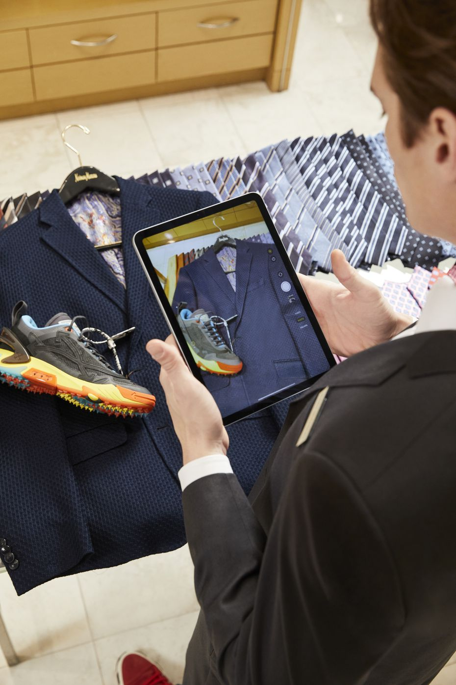 A Neiman Marcus men's stylist uses the Connect platform to help a customer shop remotely.