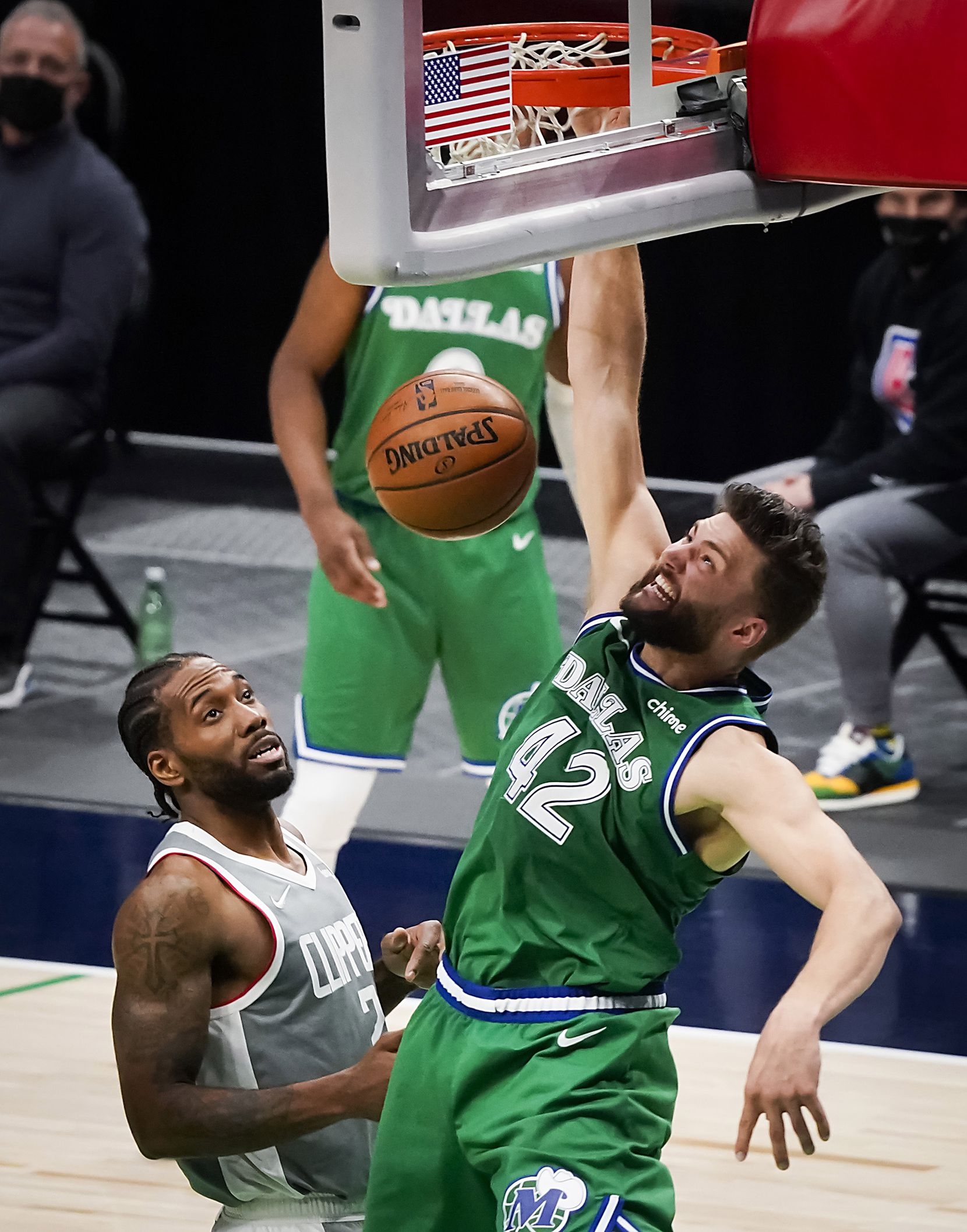 Dallas Mavericks forward Maxi Kleber (42) goes up for a slam dunk over LA Clippers forward Kawhi Leonard (2) during the second half of an NBA basketball game at American Airlines Center on Wednesday, March 17, 2021, in Dallas.