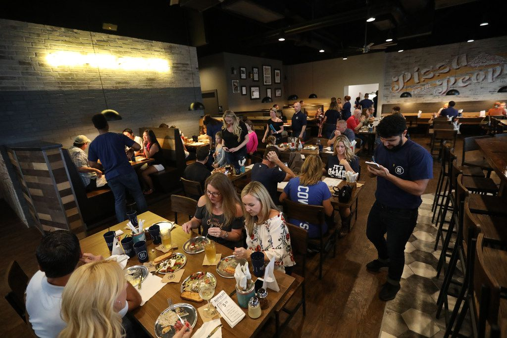 Diners during the 'friends and family' dinner at the new restaurant, Rotolo's Craft & Crust, in Frisco, Texas Saturday, Sept. 29, 2018. (Anja Schlein/Special Contributor)
