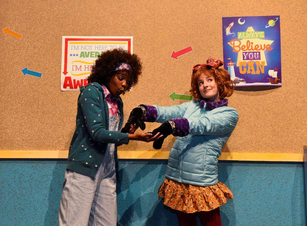 "(from l-r) Jori Jackson, playing Junie B. Jones' best friend, Grace, admires Junie B.'s new furry gloves. Mary McElree (right) plays Junie B. in Dallas Children's Theater's ""Junie B. Jones Is Not a Crook.'"