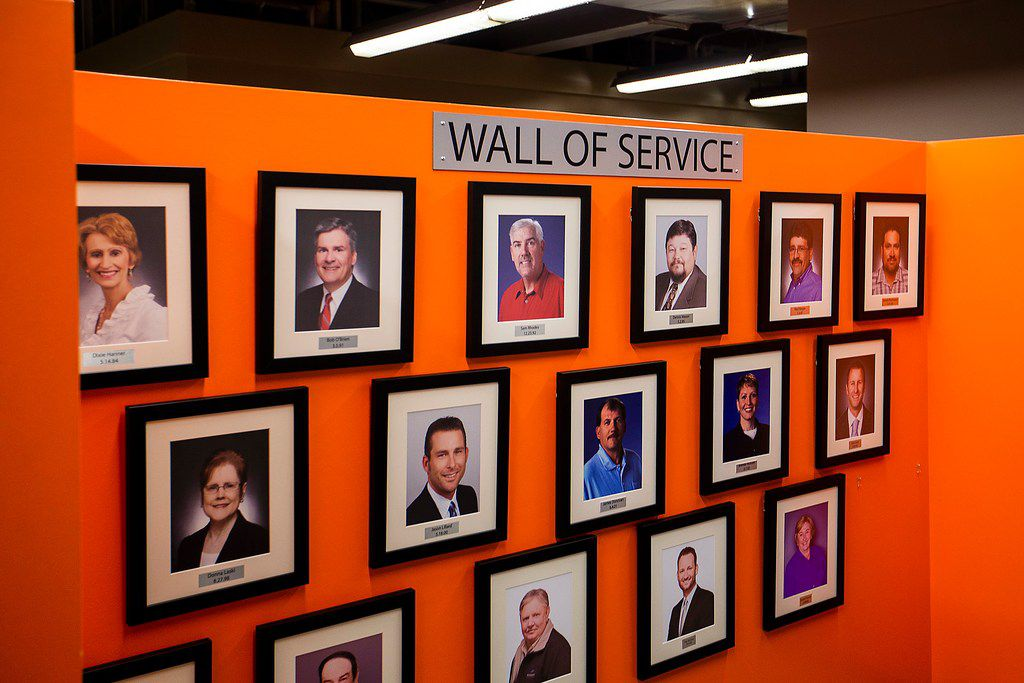A wall of service displays employee photos at Ridgemont Commercial Construction iin Irving.