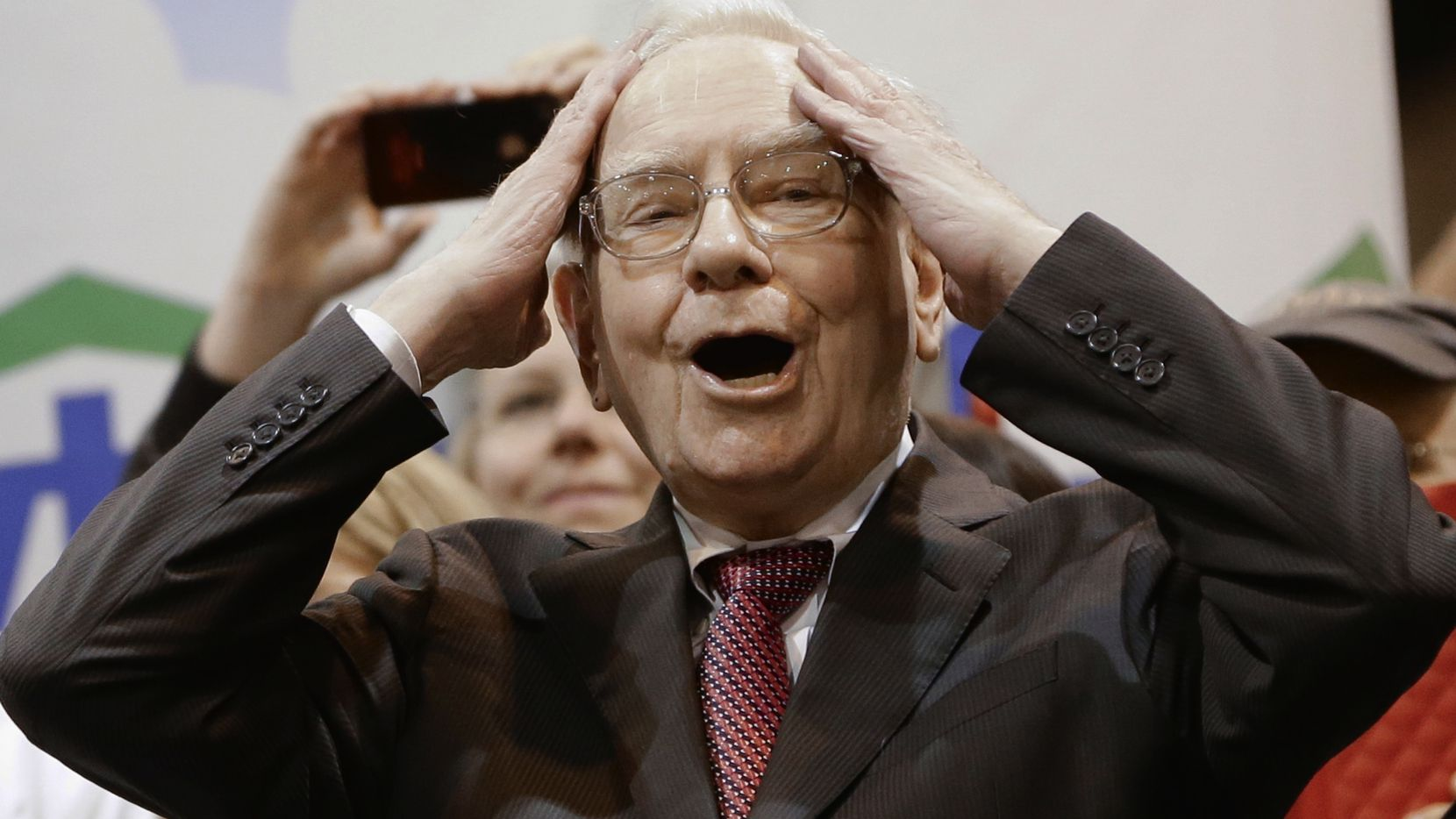 Berkshire Hathaway Chairman and CEO Warren Buffett reacted to a throw during the newspaper toss competition. Shareholders were challenged to throw a copy of the Omaha World-Herald farther than Buffett.