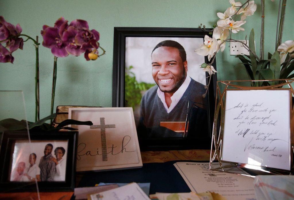 A large photo of Botham Jean with photos and cards displayed on one of the tables in his childhood home in Castries, St. Lucia, on Sept. 25.