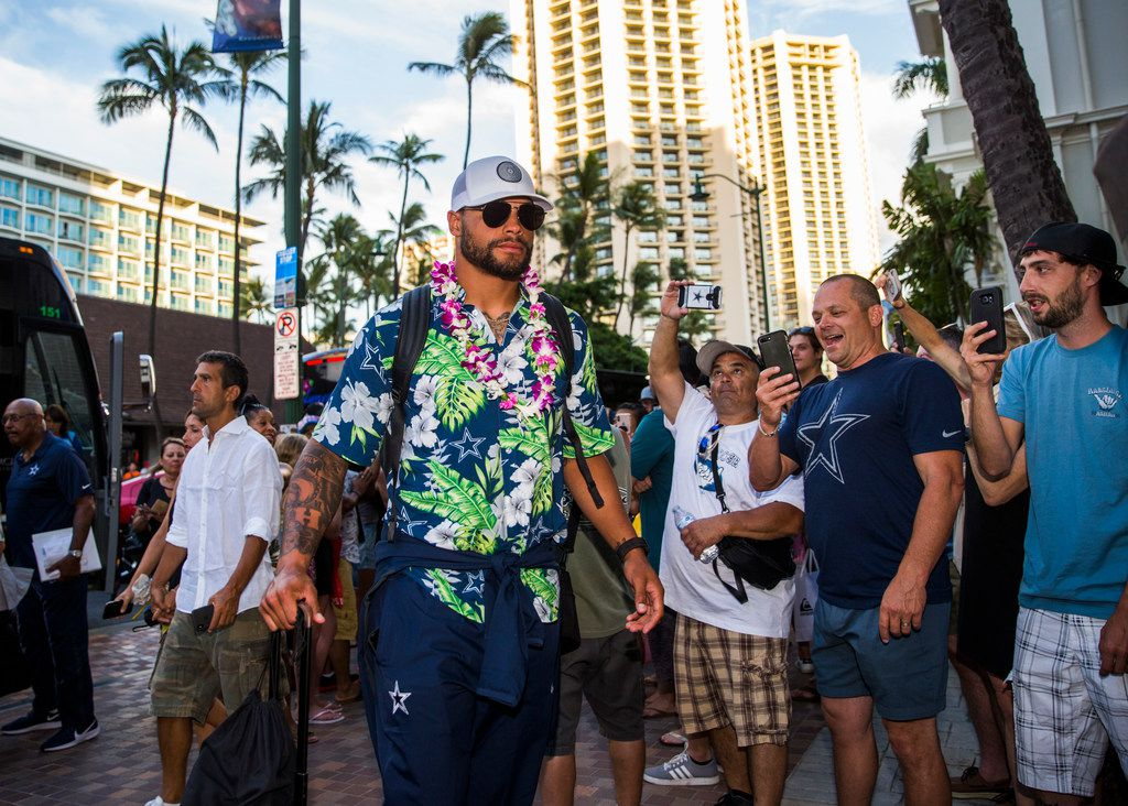 Dallas Cowboys quarterback Dak Prescott (4) and team mates arrive at the Westin Moana Surfrider hotel in Honolulu, Hawaii on Thursday, August 15, 2019. The Cowboys will take on the Los Angeles Rams in a preseason NFL game on Saturday. (Ashley Landis/The Dallas Morning News)