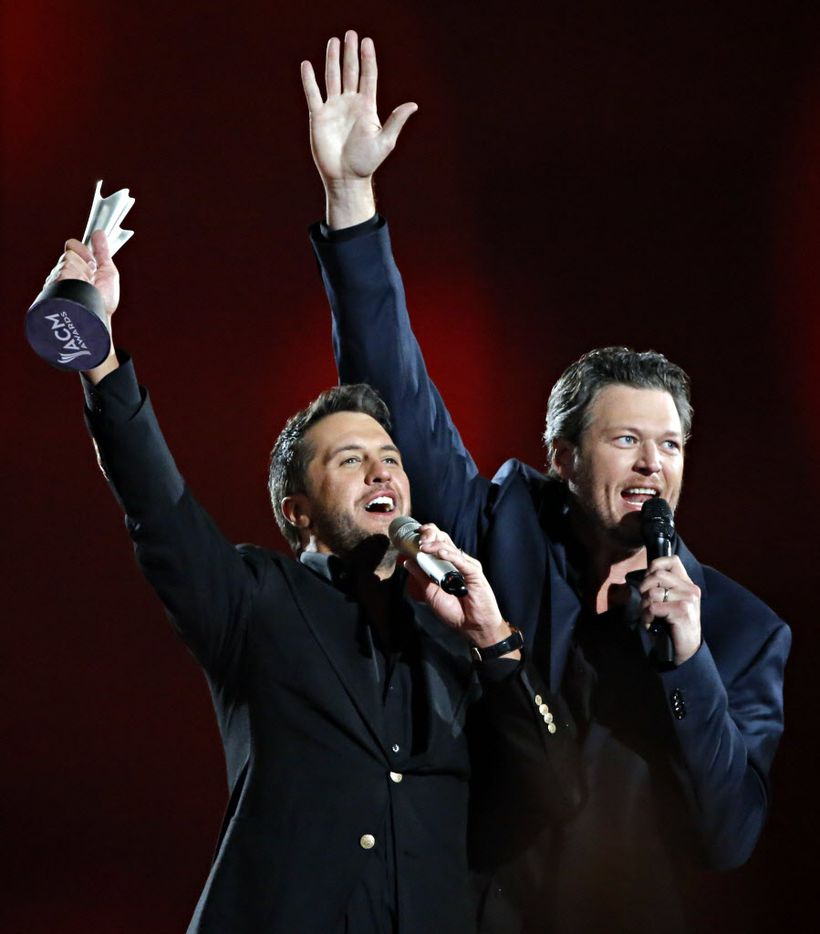 Luke Bryan (left) and Blake Shelton celebrate Bryan's winning of Entertainer of the Year during the 2015 Academy of Country Music Awards Sunday, April 19, 2015 at AT&T Stadium in Arlington, Texas.