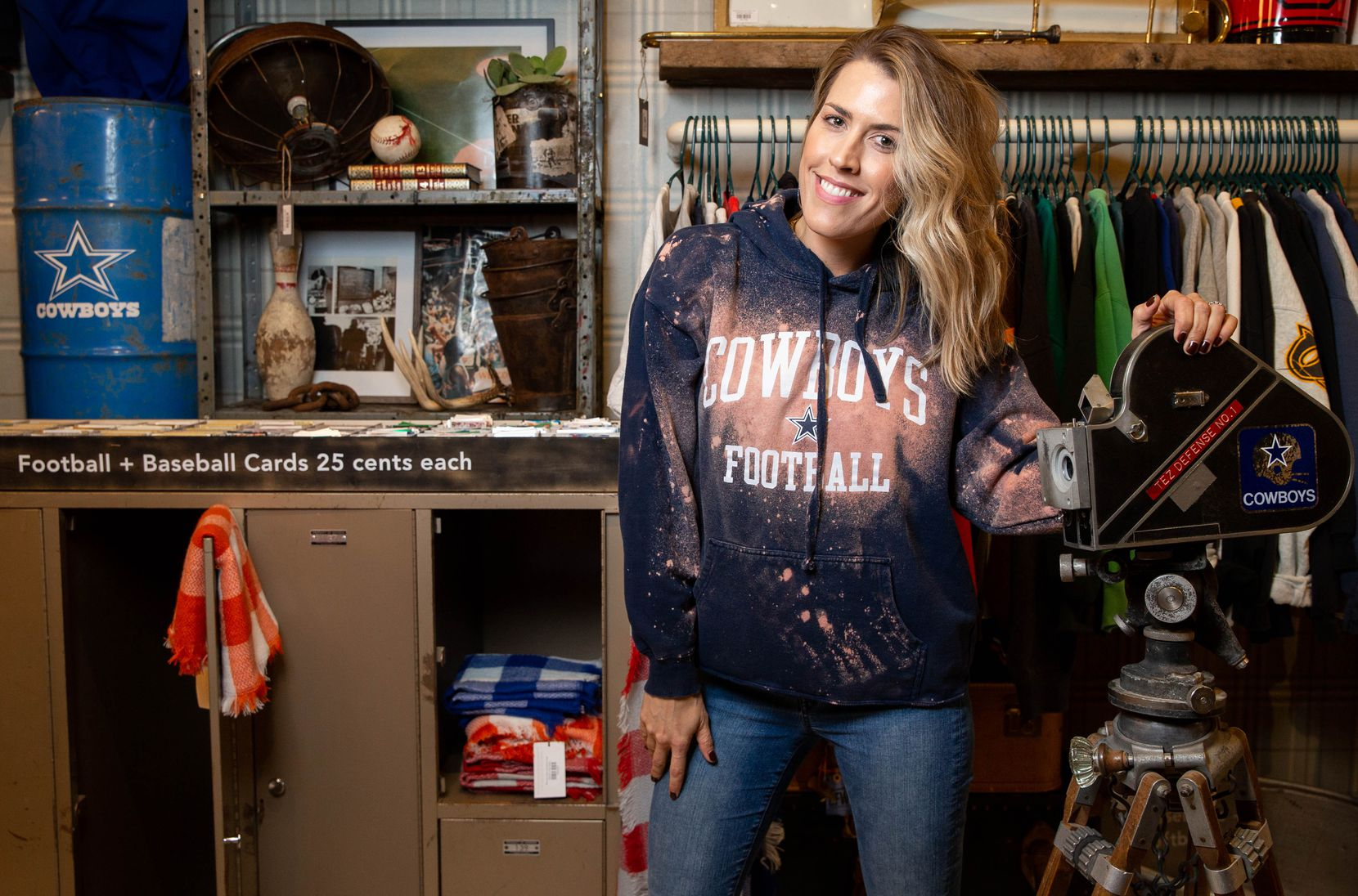 Game Day Style founder Brittany Cobb is wearing a reimagined vintage Cowboys sweatshirt at her shop across from The Star in Frisco.
