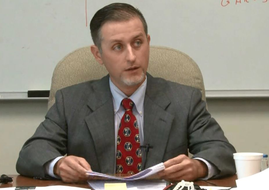 Forensic scientist Chris Youngkin testifies during a deposition in Collin County last year.