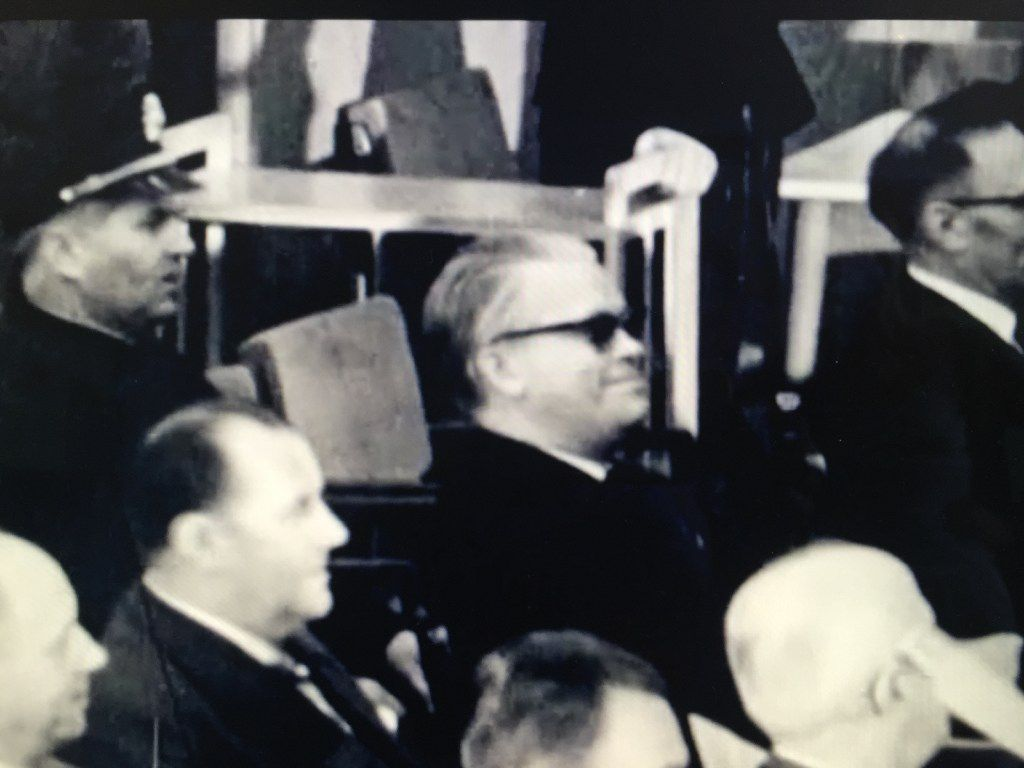 This photograph shows a seemingly cavalier Victor Capesius wearing sunglasses during his trial.