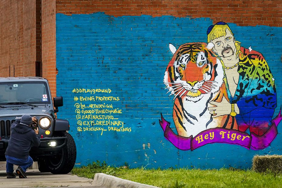 "A mural on Riverfront Boulevard in Dallas celebrates ""Tiger King."""