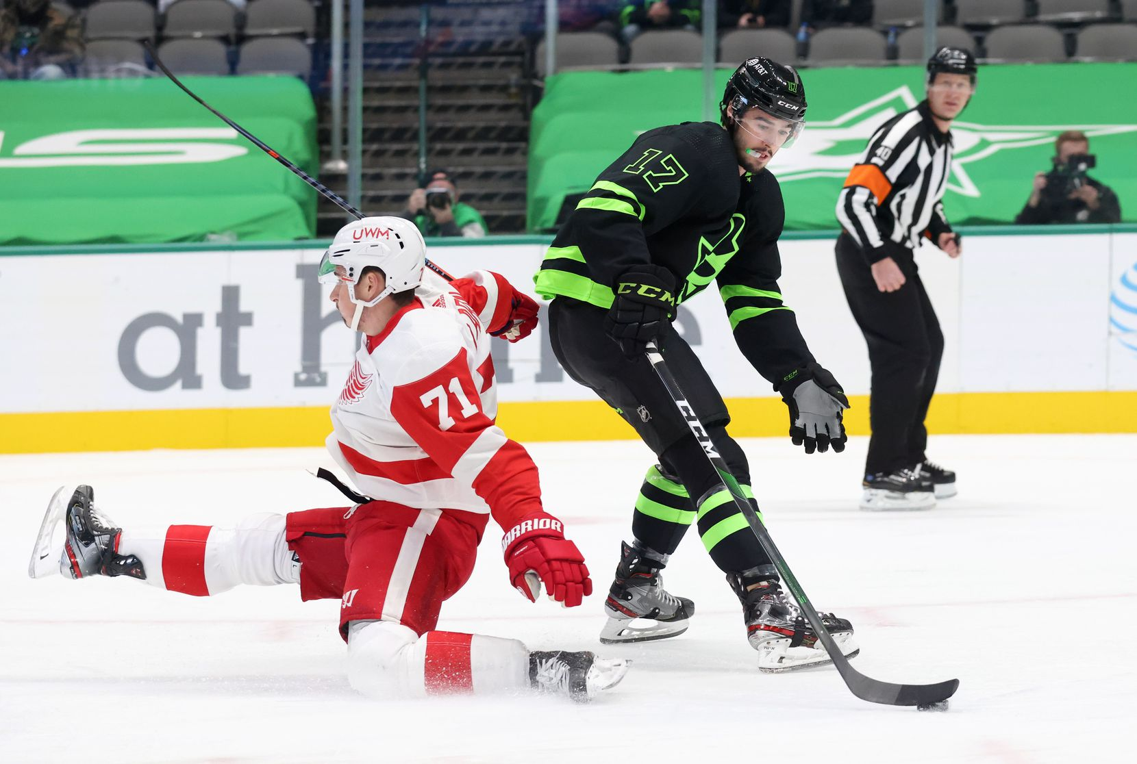Dallas Stars right wing Nicholas Caamano (17) gets by Detroit Red Wings center Dylan Larkin (71) as he falls before taking a shot on goal during the first period of play at American Airlines Center on Thursday, January 28, 2021in Dallas. (Vernon Bryant/The Dallas Morning News)
