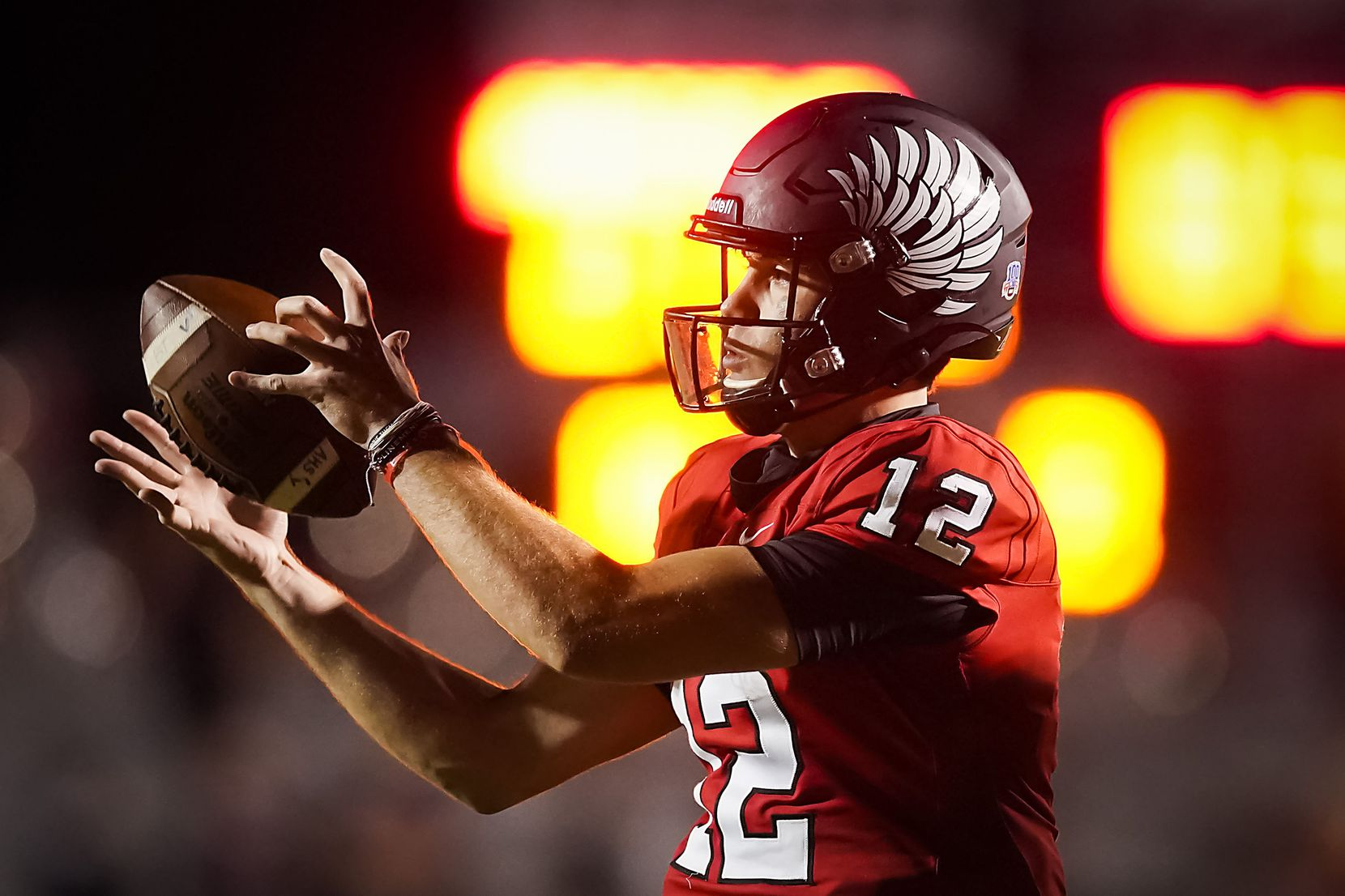 Argyle quarterback CJ Rogers grabs a snap during the first half of a high school football game against Melissa on Friday, Oct. 2, 2020, in Argyle, Texas. (Smiley N. Pool/The Dallas Morning News)