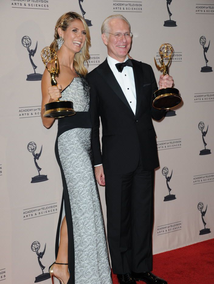 """Heidi Klum and Tim Gunn posed backstage with the awards for outstanding host for a reality or reality-competition program for """"Project Runway"""" at the Emmy Awards in Los Angeles in 2013."""