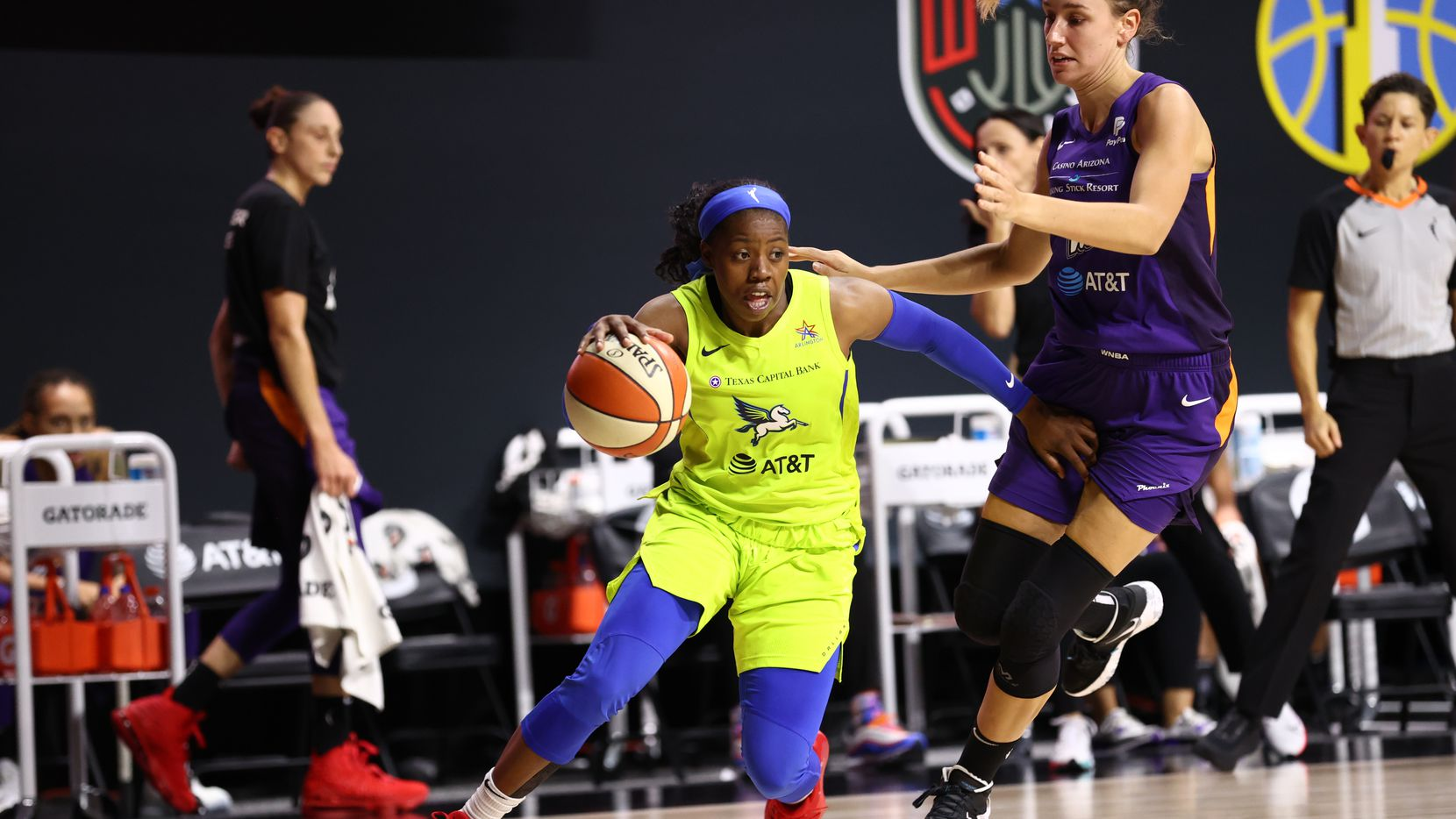 PALMETTO, FL - AUGUST 16: Arike Ogunbowale #24 of the Dallas Wings handles the ball against the Phoenix Mercury on August 16, 2020 at Feld Entertainment Center in Palmetto, Florida.