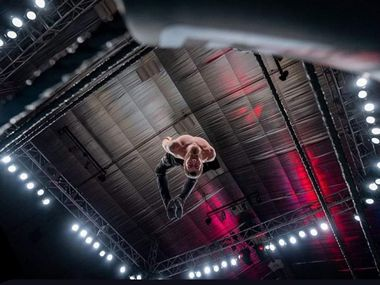 Professional wrestler Chandler Hopkins dives onto Low Ki (not pictured) during a Major League Wrestling show on Jan. 11, 2020, in North Richland Hills, Texas. (Courtesy: Chandler Hopkins, MLW)
