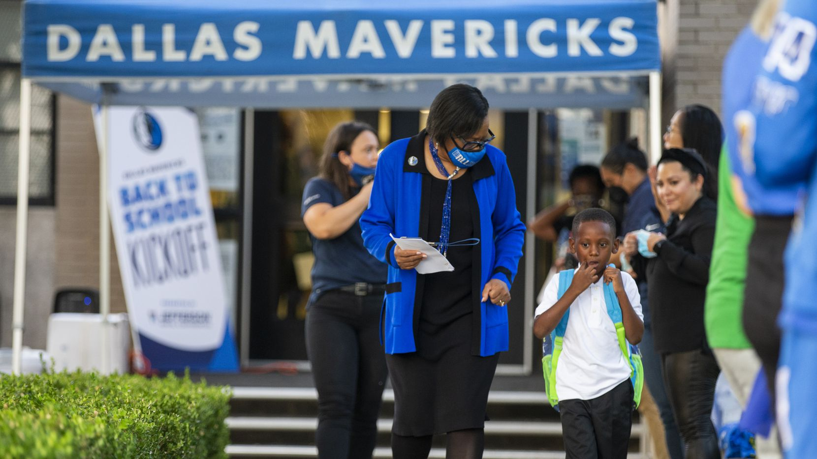 Dallas Mavericks CEO Cynt Marshall welcomes first-grader Gzia Williams, 6, to the first day of school Monday at Adelle Turner Elementary School in Dallas. (Brandon Wade/Special Contributor)