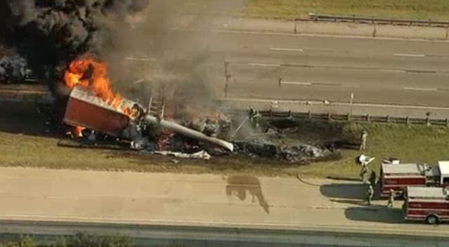 An NBC5 helicopter crew captured an overhead image of a truck burning on Interstate 20 in southeast Oak Cliff. The truck crashed into an overhead sign, overturned and caught fire Wednesday morning.