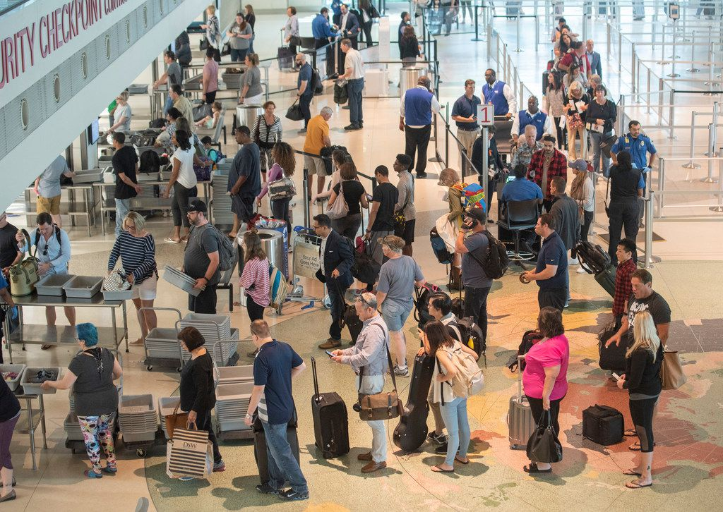 Airline Passengers wait in the security line at Dallas Love Field on Wednesday, May 23.