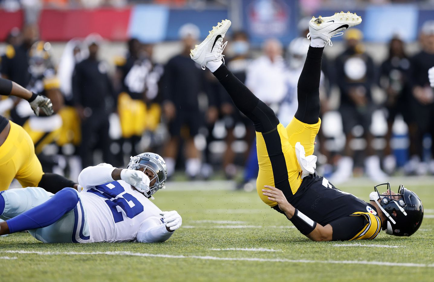 Dallas Cowboys defensive end Dorance Armstrong (92) knocks Pittsburgh Steelers quarterback Mason Rudolph (2) to the ground during a first quarter pass attempt. The Cowboys and Steelers were playing in their first preseason game at Tom Benson Hall of Fame Stadium in Canton, Ohio, Thursday, August 5, 2021. (Tom Fox/The Dallas Morning News)
