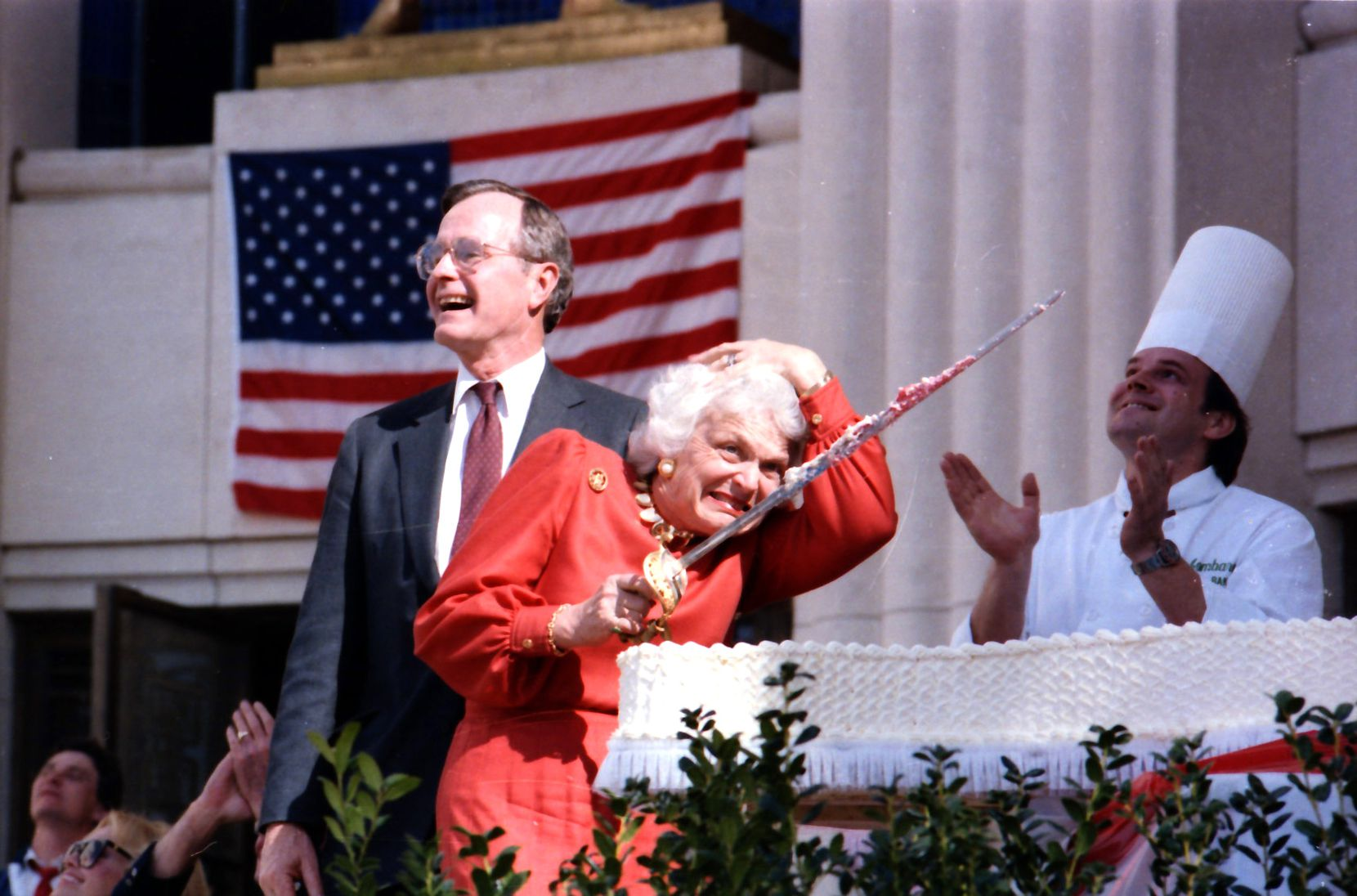 1986: Vice President George Bush laughs as his wife, Barbara, offers a startled reaction to a ceremonial fly-over by jets during cake-cutting ceremonies celebrating the Texas sesquicentennial at Fair Park in Dallas.