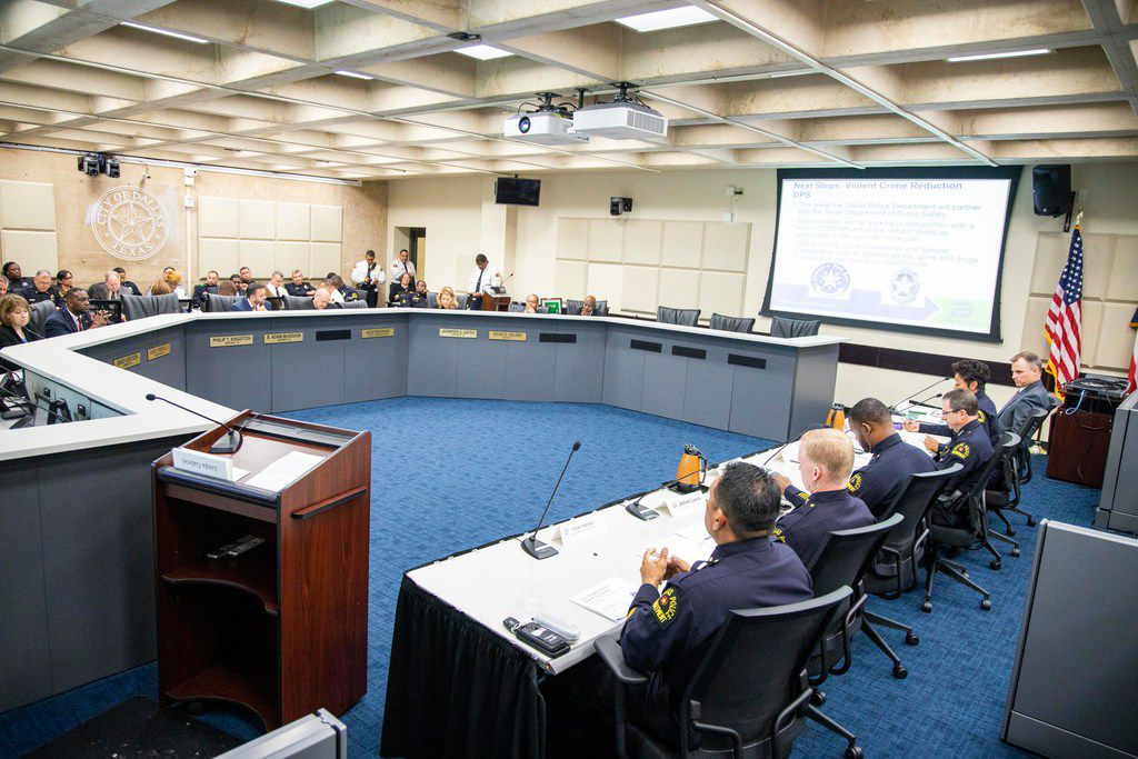 Members of the Dallas Police Department give a presentation during a Public Safety and Criminal Justice Committee briefing.