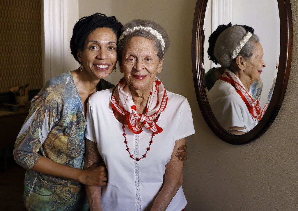 Leena Sanders, left, pose with her mother, Ruth Sanders, in Ruth's home on Monday, March 14, 2016. Ruth Sanders, 93, is in the early stages of dementia. While she can discuss the history of her neighborhood clearly and vividly, she does not understand that a large brokerage firm is currently suing her to collect money on a contract she signed in 2013 to sell her house. Whether Ruth was mentally competent when she signed the contract is a matter of debate in the lawsuit, which her family cannot afford to keep fighting, and cannot afford to pay damages on if she lose.