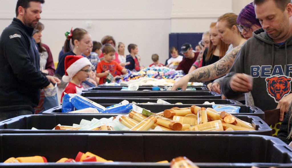 Volunteers gathered Saturday to help the North Texas Stocking Campaign stuff thousands of Christmas stockings to go to soldiers overseas and veterans in hospitals and health care centers. (Tomas Gonzalez/Denton Record-Chronicle)