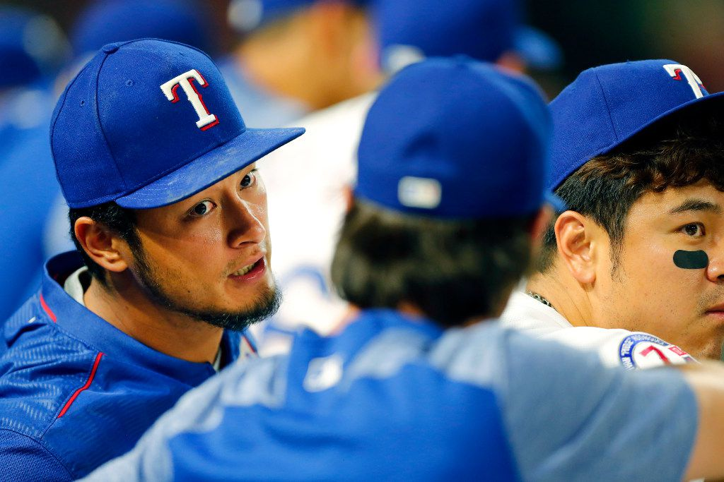 Texas Rangers starting pitcher Yu Darvish (left) came back out for the ninth inning as he visited with Cole Hamels on the bench at Globe Life Park in Arlington, Friday, July 28, 2017. (Tom Fox/The Dallas Morning News)