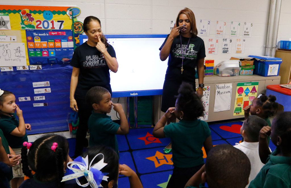 Principal Onjaleke Brown (right) participates in a song with Pre-K teacher Librada Gil and her students at N.W. Harllee Early Childhood Center in Dallas. Onjaleke started in Dallas ISD as a 3-year-old, later graduating from Kimball High School.