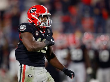 Georgia outside linebacker Azeez Ojulari (13) reacts after sacking Mississippi State quarterback Will Rogers in the final minutes of a game on Saturday, Nov. 21, 2020, at Sanford Stadium in Athens, Ga. (Photo by Kevin C. Cox/Getty Images)