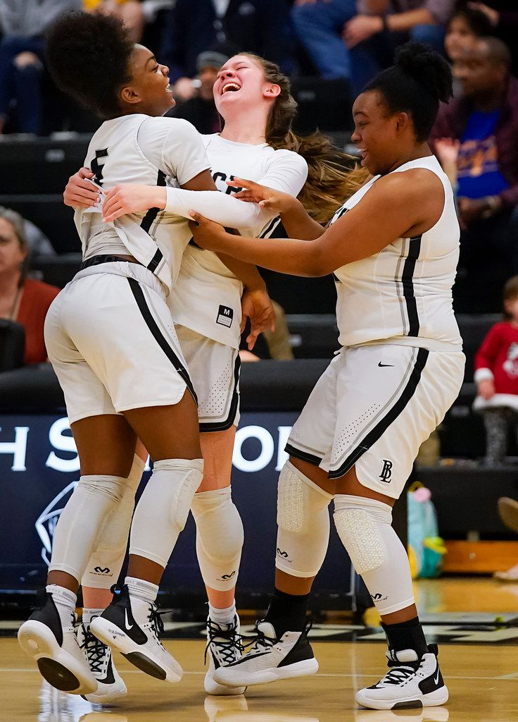Bishop Lynch guard Maddie Cockrell (5) celebrates with guard Addison Knott (center) and guard Payton Pargo (12) after a victory over Prestonwood Christian during a TAPPS 2-6A high school girls basketball game on Friday, Feb. 7, 2020, in Dallas. Bishop Lynch won the game 59-54. (Smiley N. Pool/The Dallas Morning News)