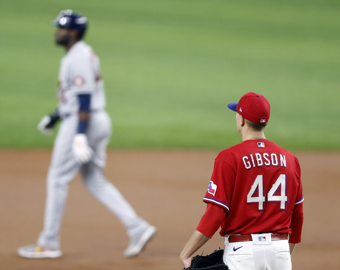 Texas Rangers starting pitcher Kyle Gibson (44) watches as Houston Astros Yordan Alvarez (44) walks to second base after walking Yuli Gurriel in the second inning at Globe Life Field in Arlington, Texas, Friday, May 21, 2009. (Tom Fox/The Dallas Morning News)