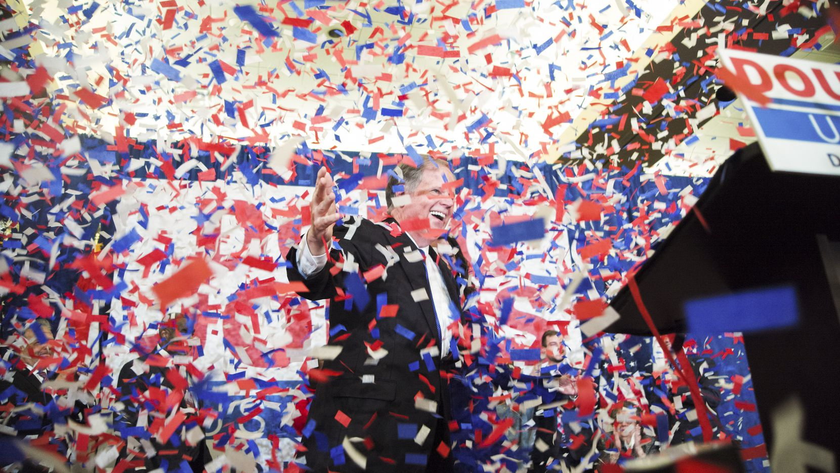 U. S. Sen.-elect Doug Jones celebrates during his watch party Tuesday in Birmingham, Ala.. Jones, a Democrat, defeated Roy Moore, the Republican candidate dogged by sexual misconduct accusations, in a special election to fill the United States Senate seat vacated by Jeff Sessions, now the attorney general.