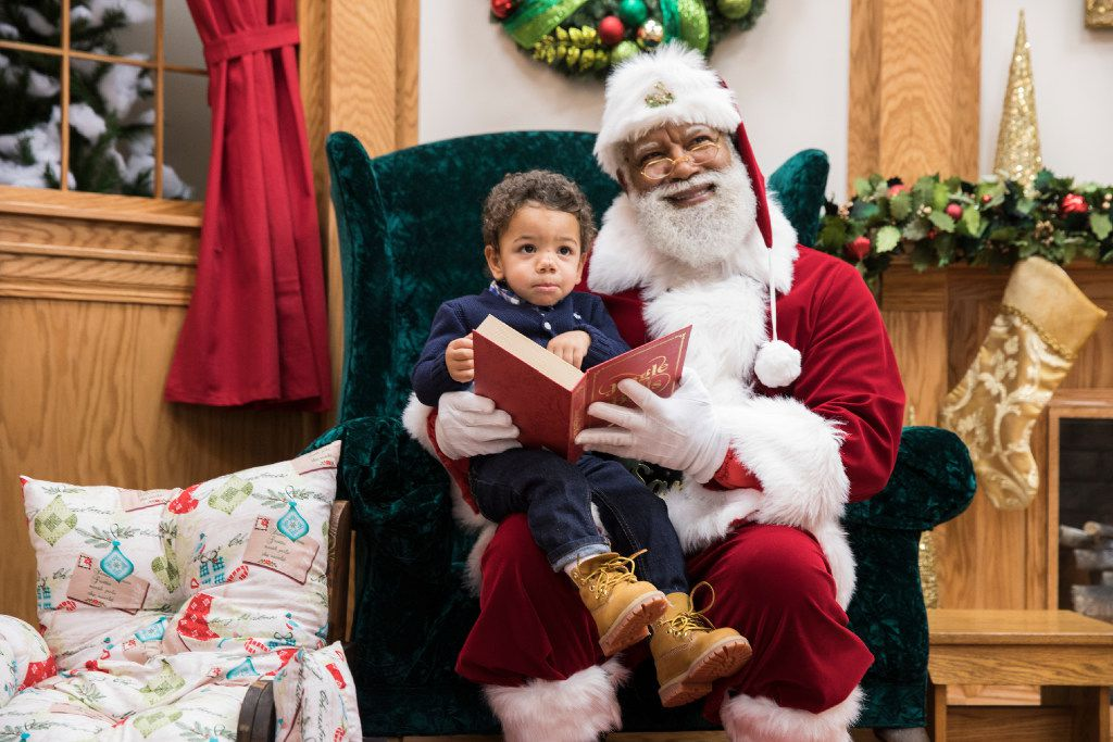 """""""Kids only see the red suit, the white beard,"""" said Larry Jefferson, who was certainly Santa to Kingston Strong of Minneapolis at the Mall of America in Bloomington, Minn."""