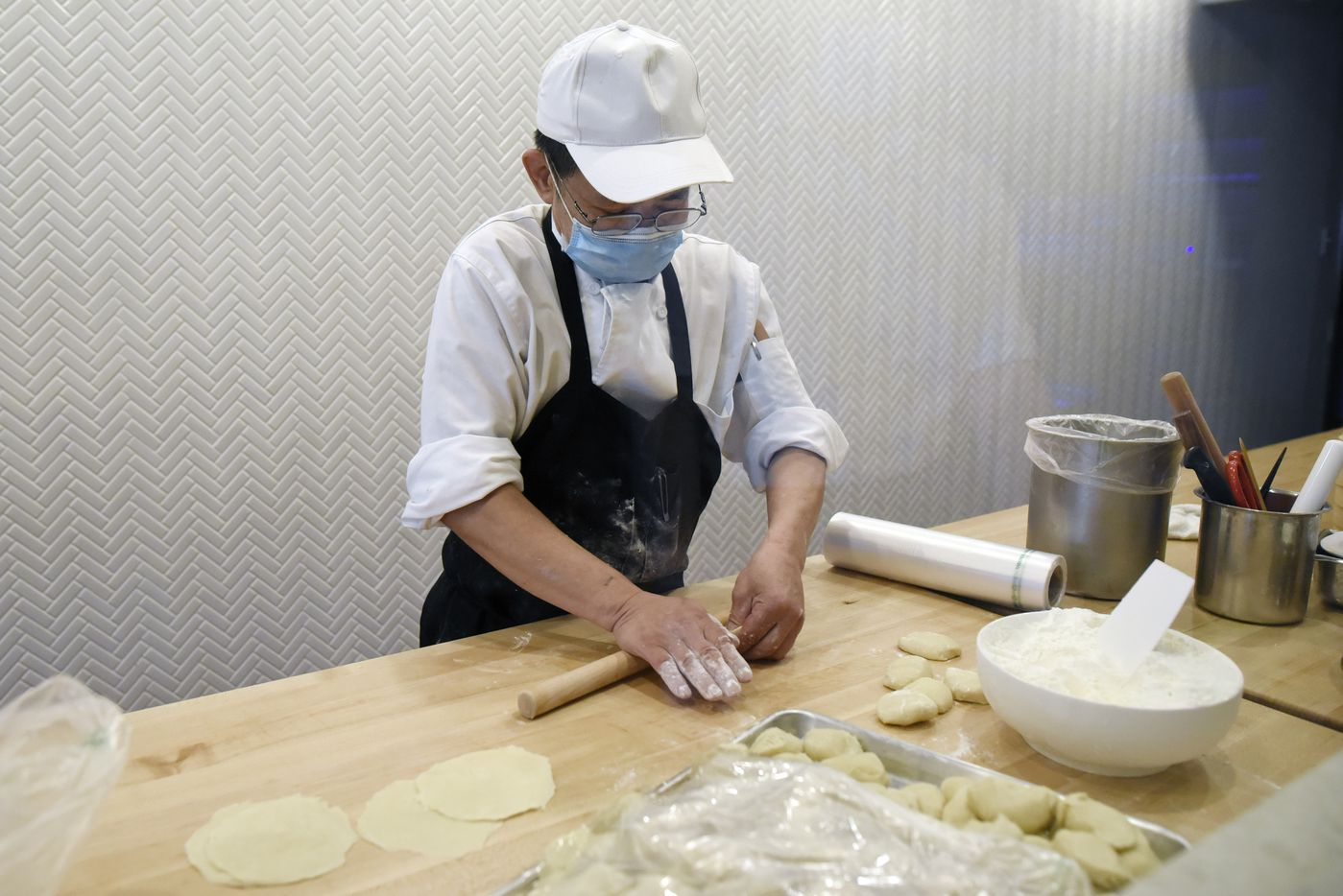 Dumpling chef Harrison Huang makes radish dumplings behind a window at Kitchen Master restaurant in Frisco, Sunday, May 31, 2020.