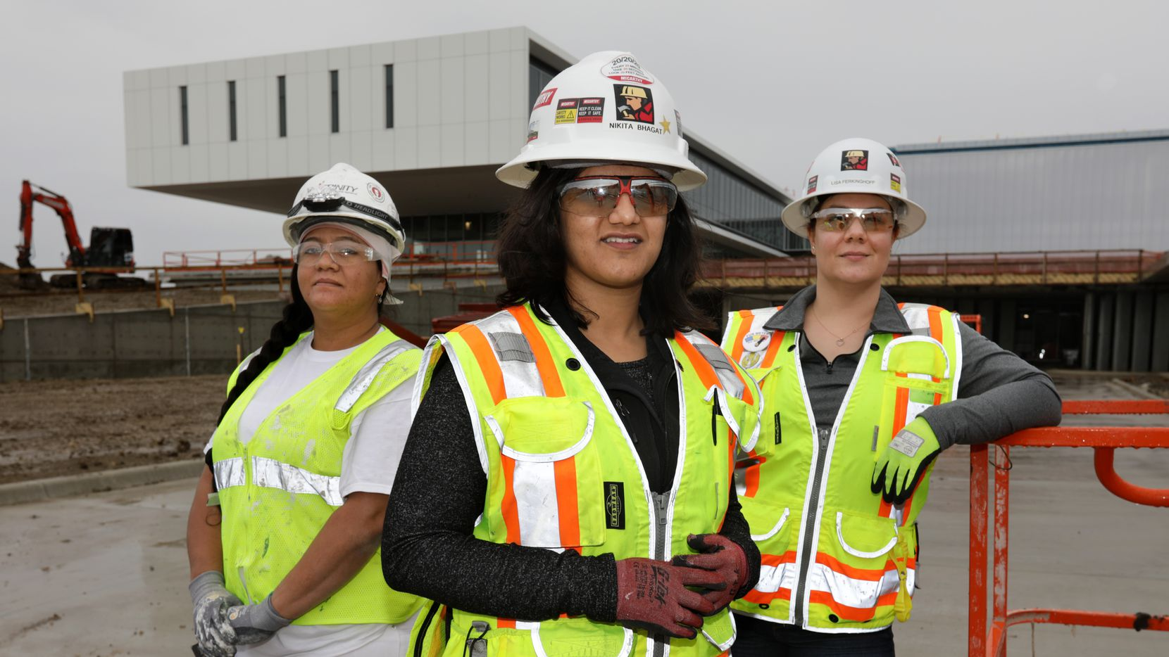 Karen Antunez, left, Nikita Bhagat, and Lisa Ferkinghoff are among the many women joining the construction industry. All three are working on the Collin College Technical Campus construction site in Allen.